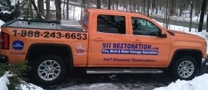 Water Damage Restoration Truck On Driveway In Winter